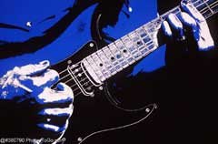 Hands playing guitar; Actual size=240 pixels wide